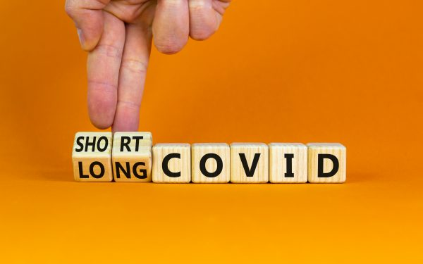 Long,Covid,Symbol.,Doctor,Turnes,Wooden,Cubes,And,Changes,Words